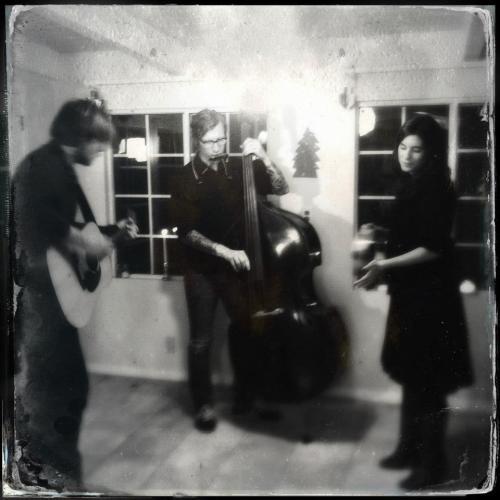 Charlie Clark, Eric McCann & Brandi Emma by Chris Carlone.
